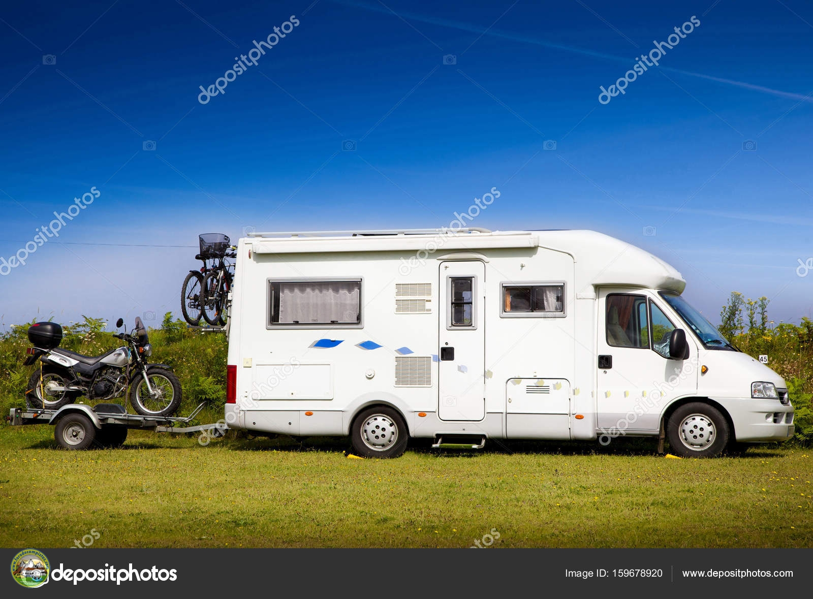 depositphotos_159678920-stock-photo-motorhome-with-motorbike.jpg